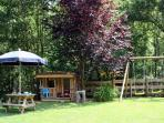 Garden with swing and playhouse, 11 acres of grounds with picnic tables and hammocks