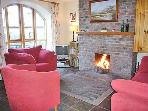 Sitting room with open fire - a warm fire welcomes our guests on the cooler evenings.