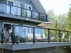 New in 2014! PVC Decking and Glass Railings make for an even more comfortable front deck