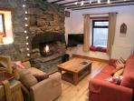 Living room with mountain views, an open fire and freesat TV