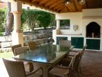 Outdoor Dining Area:   and shaded BBQ.