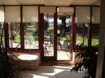 Relax with a book and a glass of wine in the conservatory