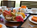 Breakfast is fruit, eggs, toast, juice, tea or coffee
