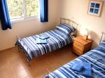 Bright comfortable twin bedroom