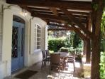 Covered dining terrace with comfortable seating for 6 guests, new teak dining table and gas BBQ,