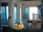 From kitchen looking out through the dining room to the ocean with the pool on the left, balcony frt