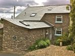 One Fern Cottages - stunning 16th Century stone cottage, with oak beams. Sleeps 5. Private parking.