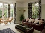 Sitting Room - with French doors leading to outside balcony.