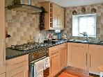 Fully equiped kitchen, large fridge and freezer, microwave, washing machine,fold up dining table