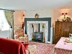 Feature inglenook,cosy gas coal effect fire, rugs,oak floor, TV,DVD player & library of books & DVDs