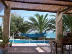 veranda, piscina, palme e mare