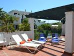 Fantasic large sunny terrace with patial shaded area overlooking the gardens and pools