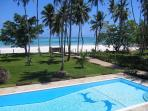 Magnificant view on pool, garden and the white sandy beach.