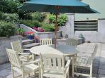 Al fresco -enjoy eating out in the sunny garden at the large wooden table and chairs