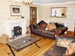 Spacious living room with log burner