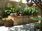 Enjoy the shade of the coutyard by the fish pond.
