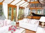 Beautiful conservatory overlooking pool and views