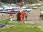 Budhist monks on the beach