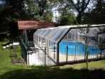 Pool with sliding enclosure