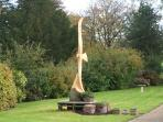 OUR 10FT HIGH RED KITE CARVED AFTER THE BLUE SPRUCE DIED