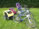 A selection of child bicycle trailers and child seats for younger children free to use.