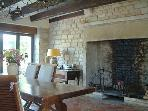 ... or in the dining room, which easily seats 12 and has a large fireplace for cooler evenings