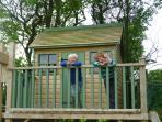 Tree house with swings, slide and rope bridge plus brand new trampoline.