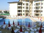 The main pool with sunloungers and parasols; convenient to apartments