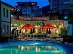 The swimming pool and restaurant at night