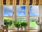 Look out on  to amazing country views. Plenty of fresh herbs in the garden.