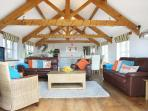 Open planned living area with vaulted ceilings and oak floors