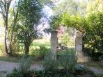 through the gate to the private garden and stone picnic table