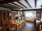 The heart of any good home, the beautiful kitchen with wooden beams and a range cooker