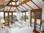 Conservatory overlooking swimming pool