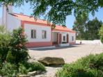 Casa Rosa, set in a large mediterranean garden with secure gated entry overlooking open countryside.