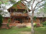 Alegria - Beautiful Bush Cottage. Front of the Cottage with large terraces and Boma Area