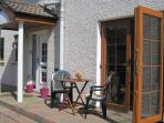 You can enjoy al fresco dining using furniture provided for the patio accessed from the Lounge.