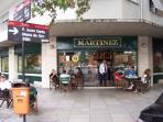 Cafe Martinez on closest corner.
