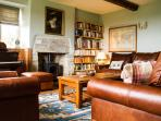 A fabulous selection of books with hard covers - Fine paintings & Eastern rugs grace the floors