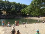 Sunbathe at Bize's famous river beach