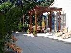 Secure & private terrace with Pergola & table /chairs for 8 persons