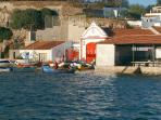 Lifeboat station on the harbour near tradtional restaurants.