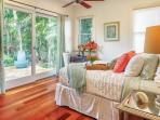 Bedroom four, with queen bed and shared bath, mauka (mountain) wing.