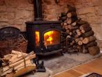 Inglenook fireplace with woodburner, oak floor