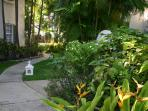 Set in beautiful tropical gardens, the short path to the beach.