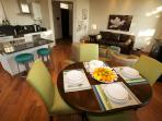 Spacious and bright dining area, expandable table, comfortably seats 6-9