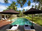View of pool with sun loungers