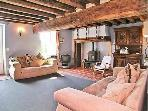 Lounge with woodburner, English freeview TV and Wi-Fi.
