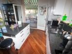 Fully equipped kitchen, opens onto deck, perfect for outdoor dining