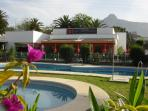los naranjos bistro with pool and sun bathing area